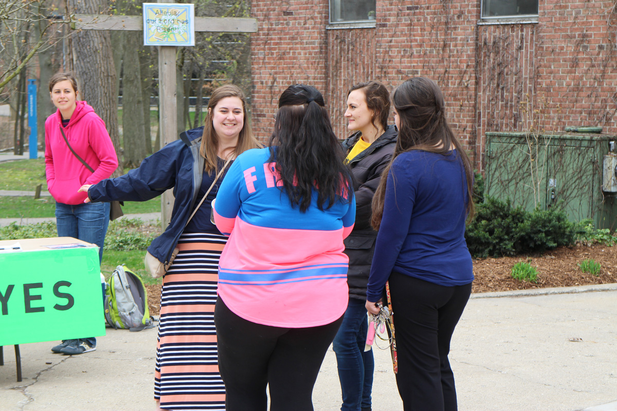 Pictured: Dialogue story - Rachel and Chloe talking to students at Aquinas College.