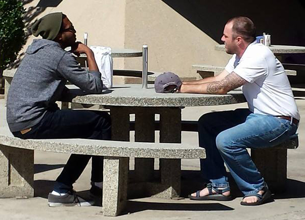 Jacob Nels talking to a student at CSU Bakersfield.