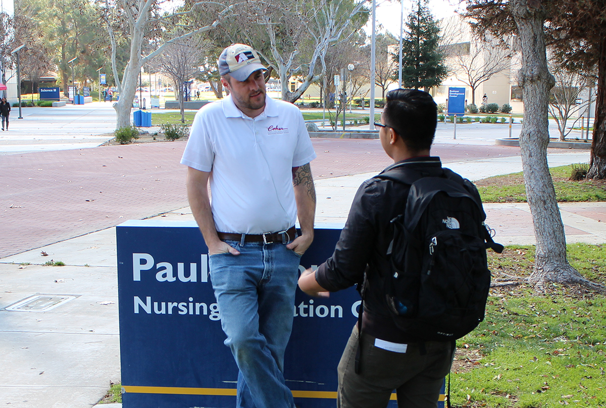 Jacob Nels talks to a student at CSUB.