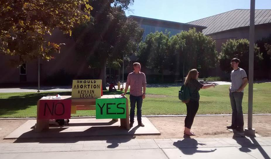 "On September 26th, 2014, Equal Rights Institute trained a group of Biola University students. Then on September 30th we brought them to CSU Fullerton so they could put what they learned about dialogues about abortion into practice. We set up the ""Should Abortion Remain Legal"" poll table the way we have for years."