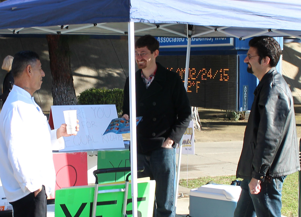 Timothy and Josh Brahm dialogue with one of the CSU Bakersfield staff about abortion.