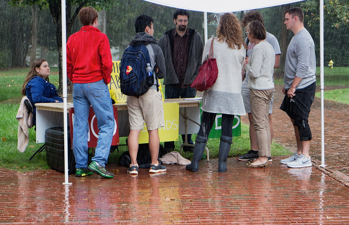 Josh Brahm (middle) has a conversation with students at Davidson College while Rachel Crawford (left) watches. We don't have a picture of the actual conversation in this article, but it took place in the same spot.