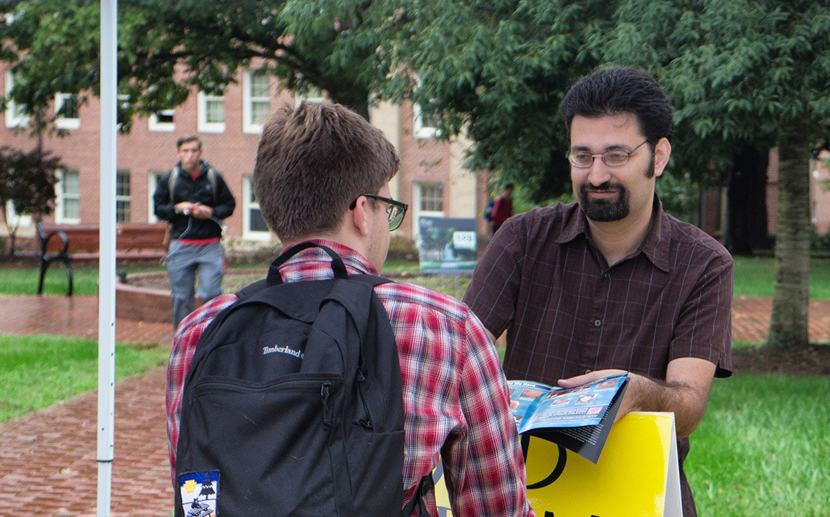 Picture: Josh Brahm talking to a student about viability at Davidson Community College