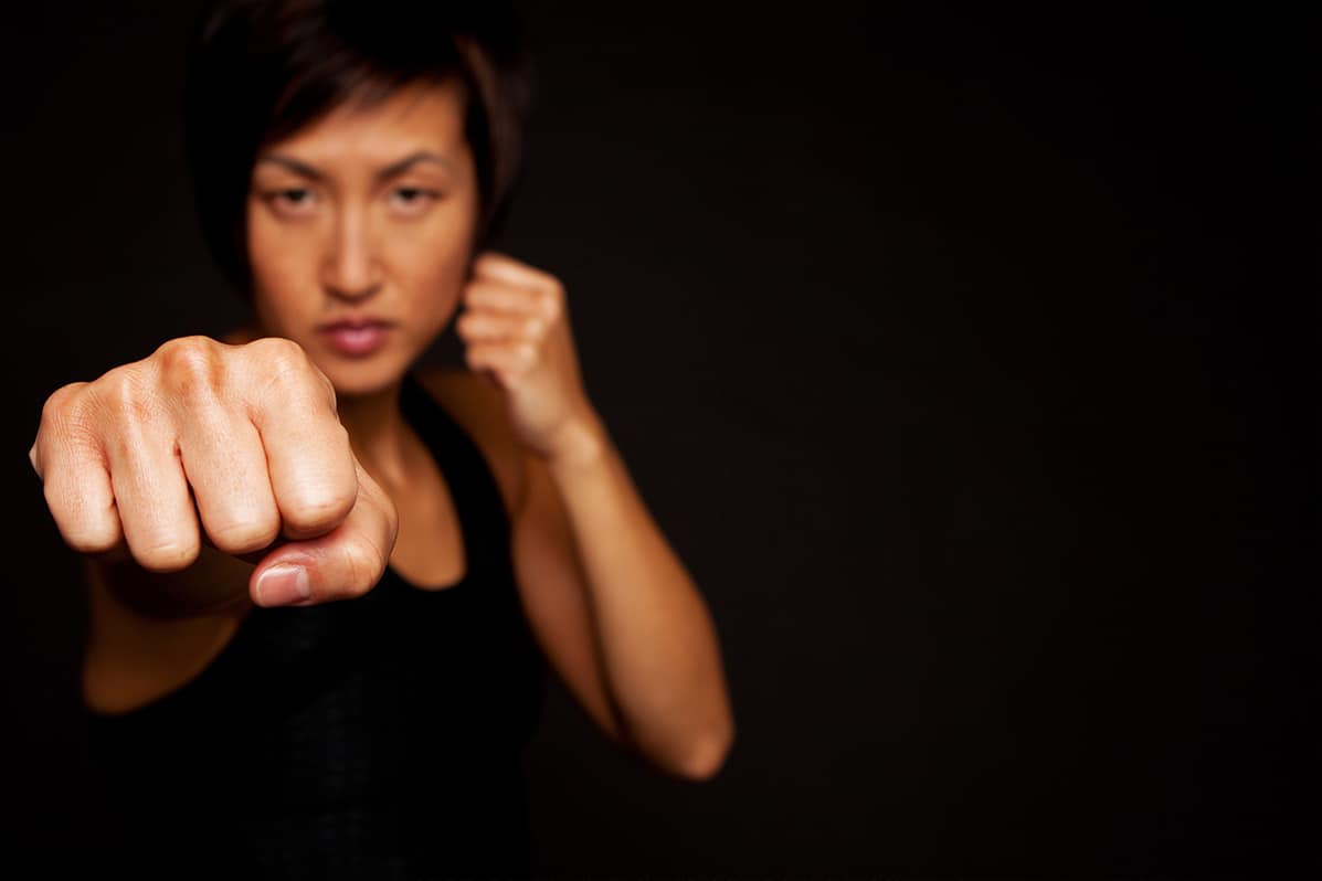 A woman in a self-defense position.