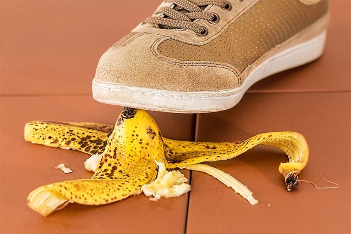 Shoe stepping on banana peel