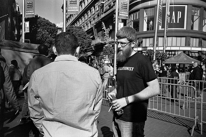 Abortion abolitionist man talking to another man